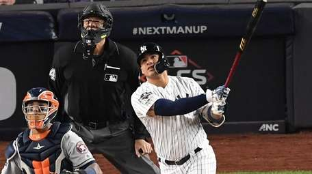 Yankees' Gleyber Torres watches the flight of his