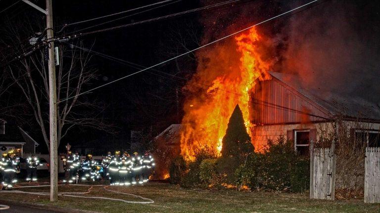 Firefighters battle a blaze that left one man