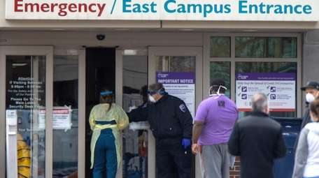 Health care workers outside the emergency room at