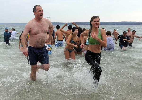 Participants in the Northport Polar Bear Plunge jump