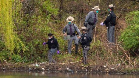 State Police investigate the scene at Mullener Pond