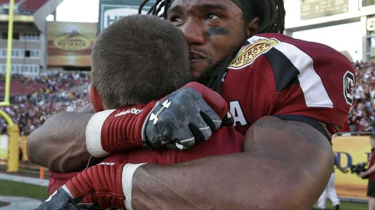 South Carolina running back Kenny Miles (31) celebrates