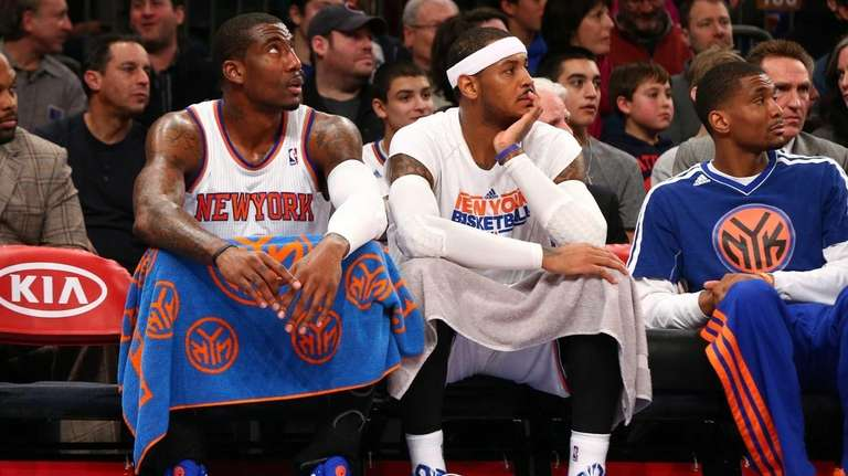 Amar'e Stoudemire and Carmelo Anthony look on during