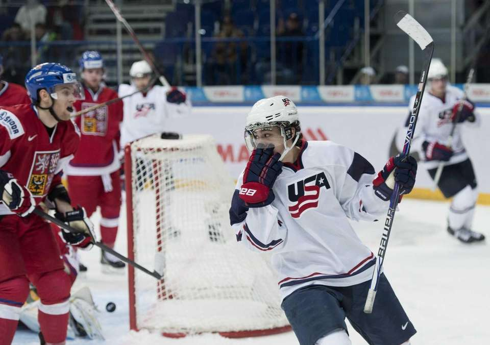 Team USA forward John Gaudreau, right, scores past
