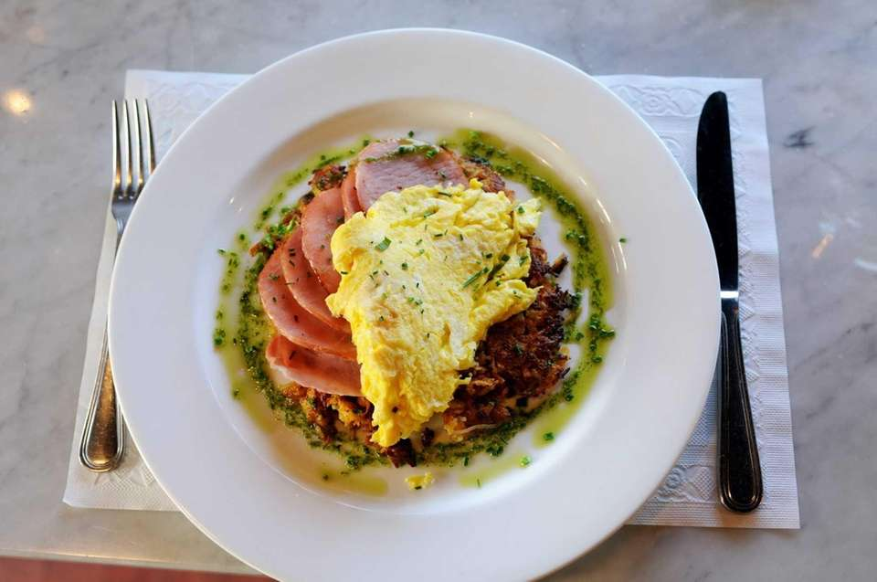 Pan-sauteed sweet potato cake topped with Canadian bacon,