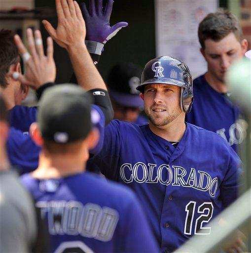 Colorado Rockies' Andrew Brown celebrates with teammates in