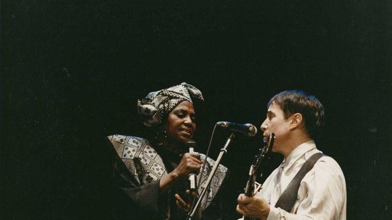 Miriam Makeba sings with Paul Simon.