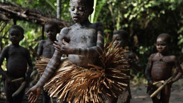 A Mbuti Pygmy boy participates in manhood initiation