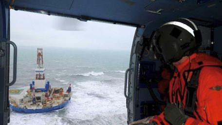 Coast Guard Rear Adm. Thomas Ostebo looks out