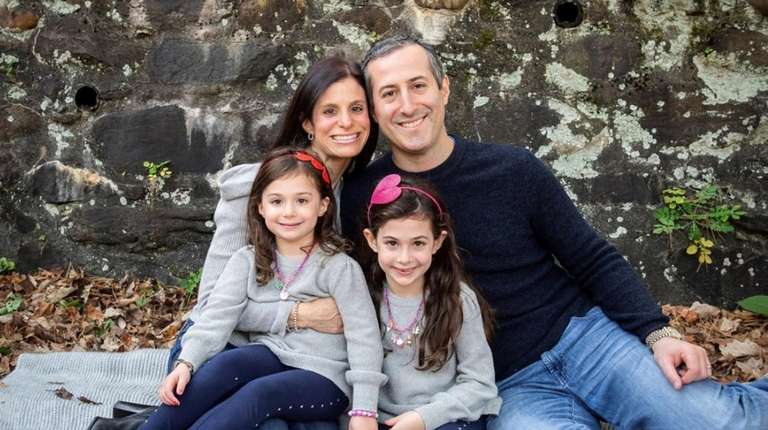 Adam Lilling, pictured here with daughters Ariel, 4,