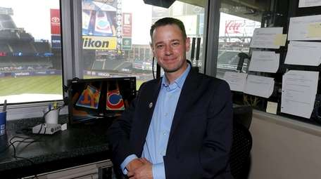 Mets public address announcer Colin Cosell poses for