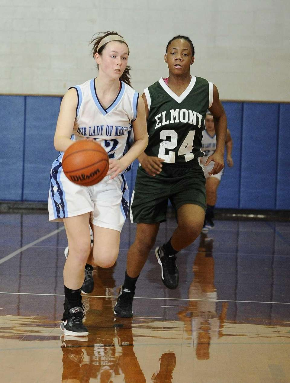 Our Lady of Mercy's Shannon Brady controls the