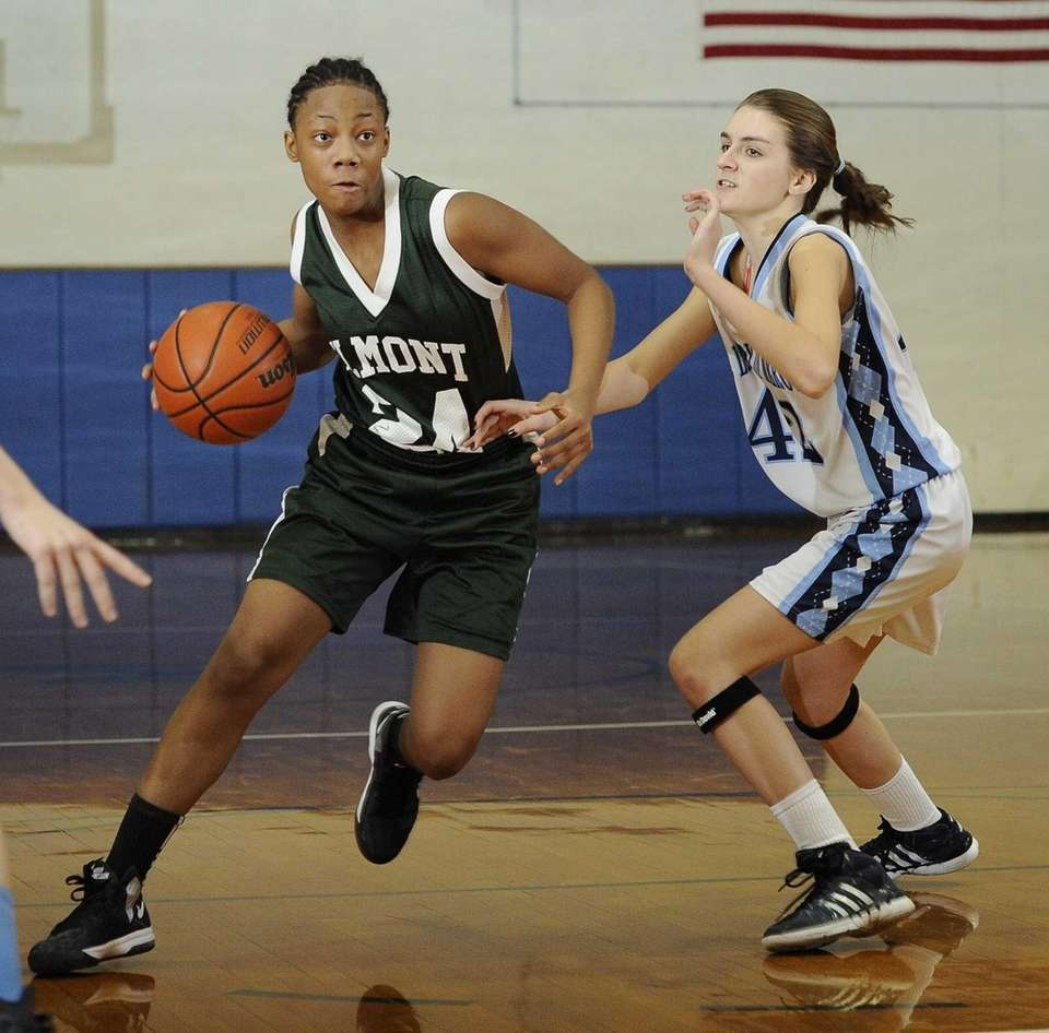 Elmont's Tatiana Laroche drives the ball around Our