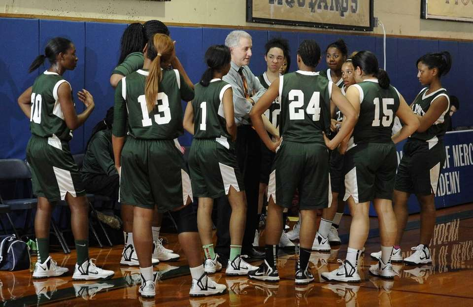 Elmont head coach Tom Magno directs his players
