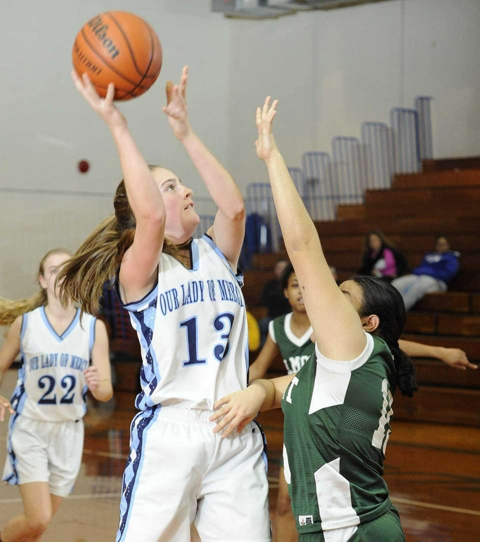 Our Lady of Mercy's Samantha Lynch shoots over