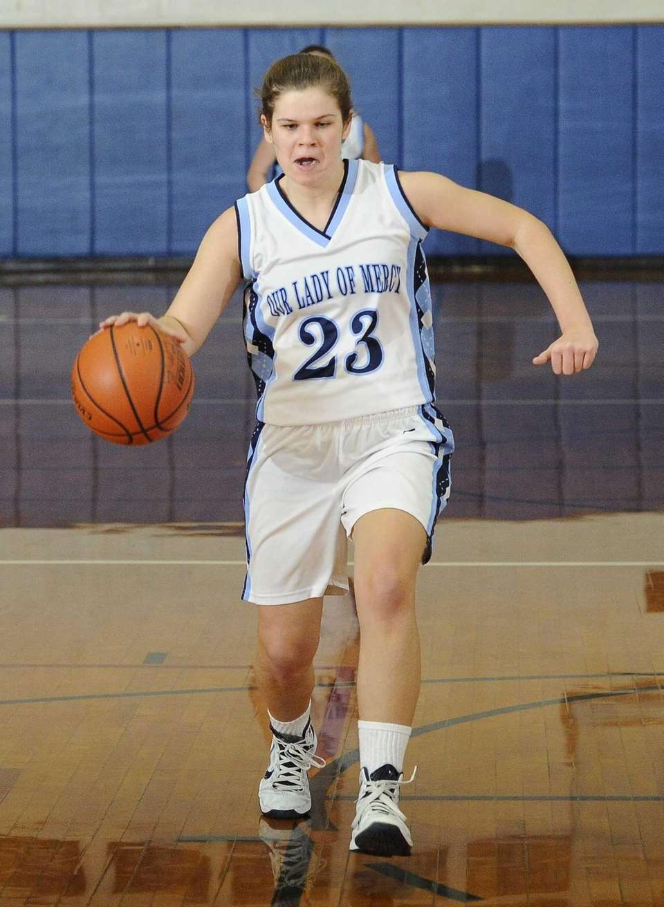 Our Lady of Mercy's Renee Rios controls the