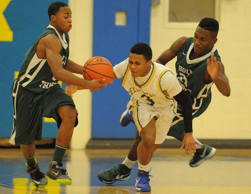 Holy Trinity's Damon Coleman, left, and teammate Isaiah