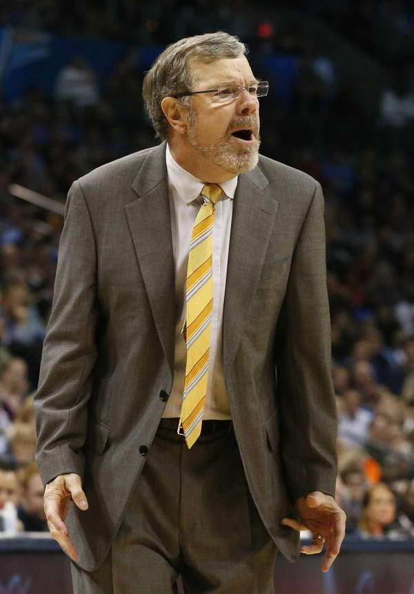 P.J. Carlesimo shouts to his team in the