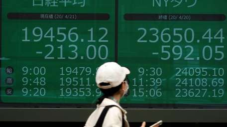 An electronic stock board shows Japan's Nikkei 225