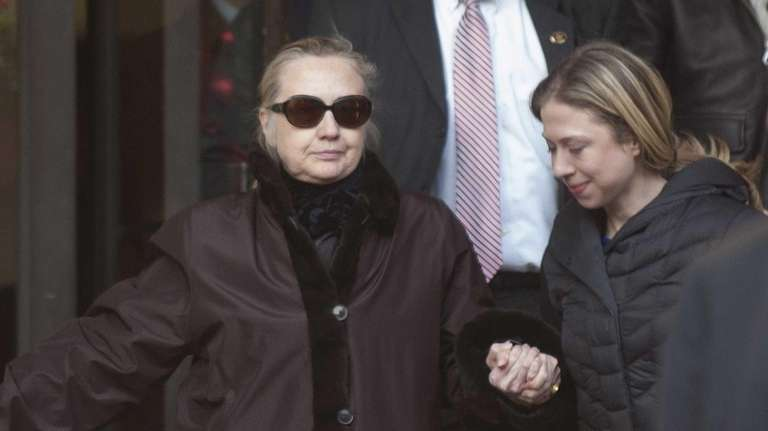 Secretary of State Hillary Rodham Clinton exits the