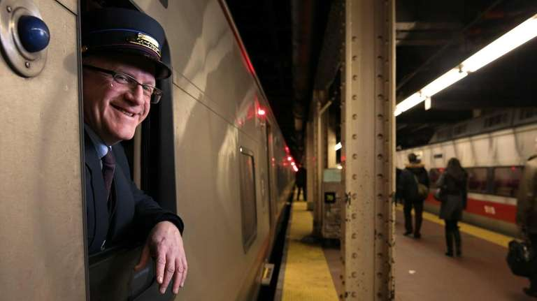 Robert McDonough, a conductor for Metro-North Railroad, leans