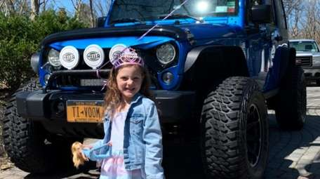 Six-year-old Isabella Lucchi of Miller Place, in front