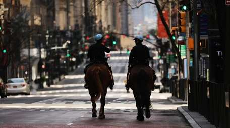 NYPD  officers on horses ride on Fifth