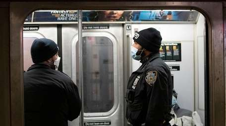 New York police officers wear masks while patrolling