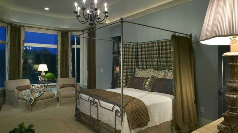 A romantic bedroom features varied lighting and small