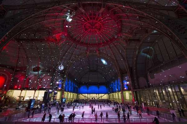 People skate on an ice rink hosted in