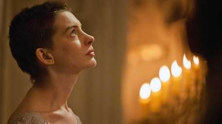 Anne Hathaway plays Fantine, a struggling, sickly mother