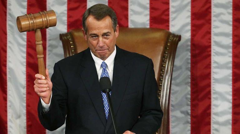 Speaker of the House John Boehner holds the