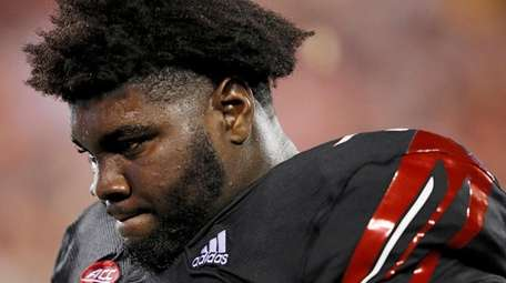 Mekhi Becton of the Louisville Cardinals reacts in