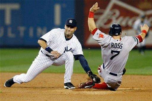 Derek Jeter catches Boston Red Sox outfielder Cody