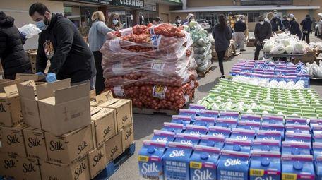 Volunteers work with Island Harvest food bank to