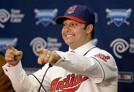 Cleveland Indians outfielder Nick Swisher gestures as he