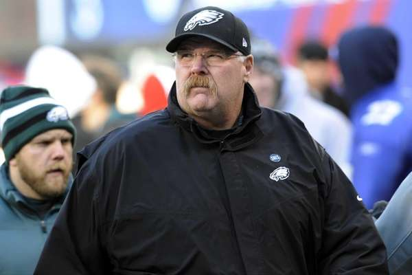 Philadelphia Eagles head coach Andy Reid walks on