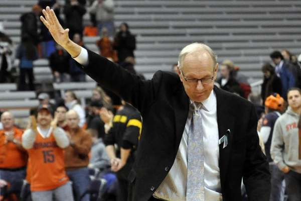 Syracuse head coach Jim Boeheim acknowledges the fans