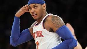 Carmelo Anthony celebrates a 3-point basket in the