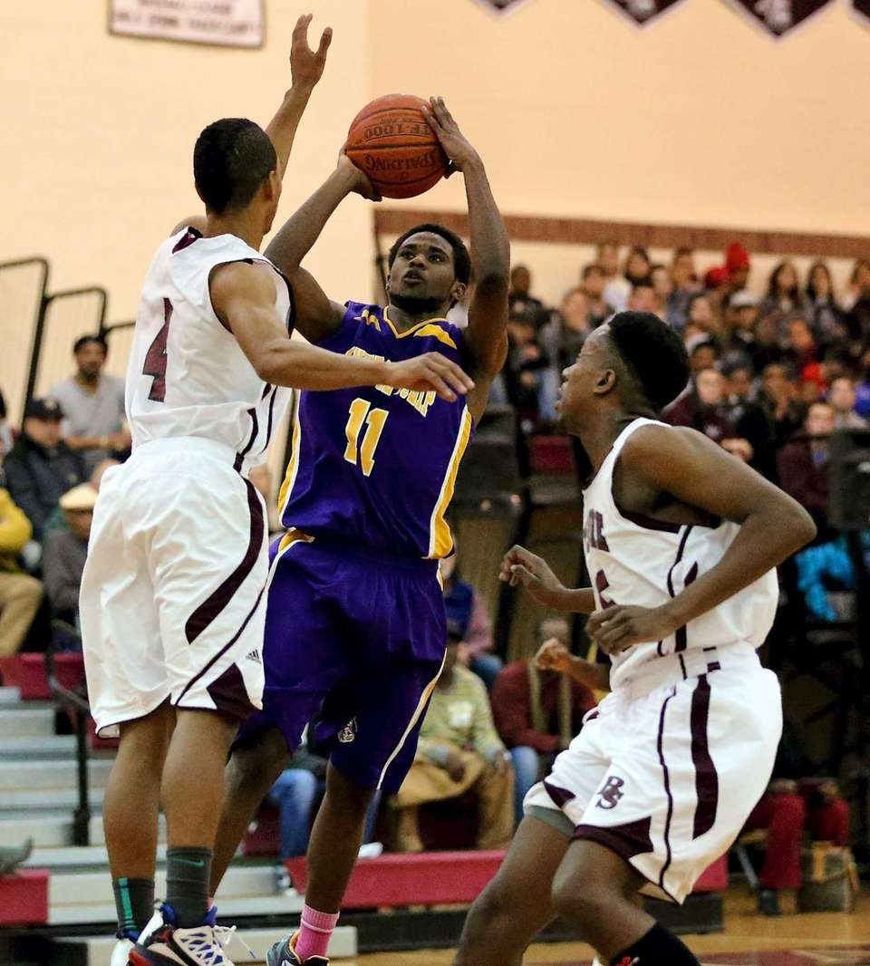 Central Islip's Ishiah Booker gets the shot off