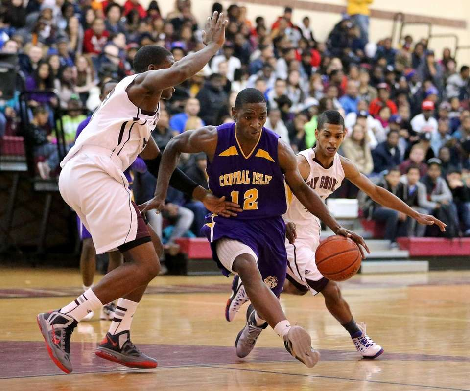 Central Islip's Tim McKenzie tries to split the