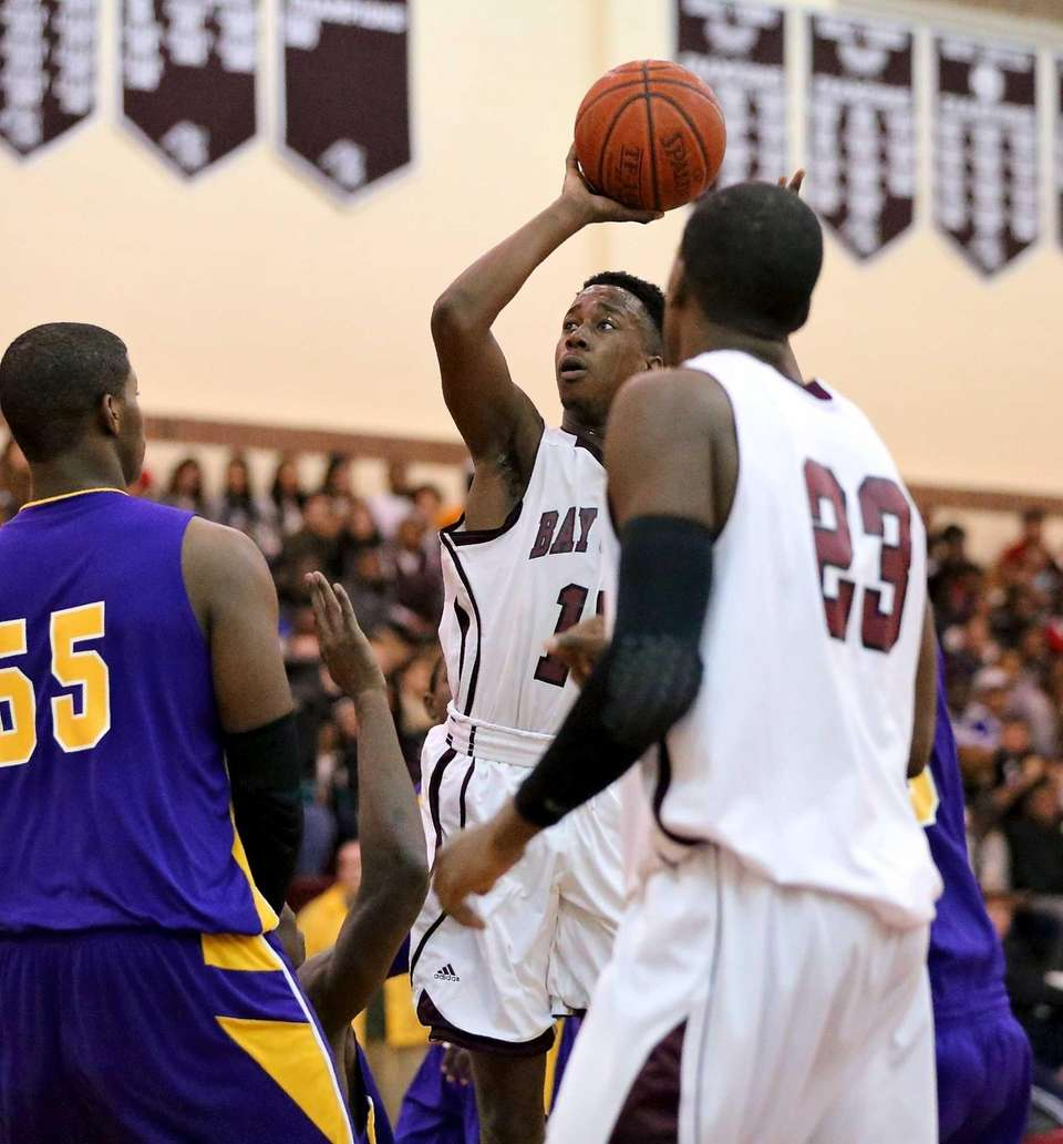 Bay Shore's Jason Wright puts the shot up