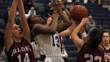 Huntington's Joellen Ceide (13) is fouled going for
