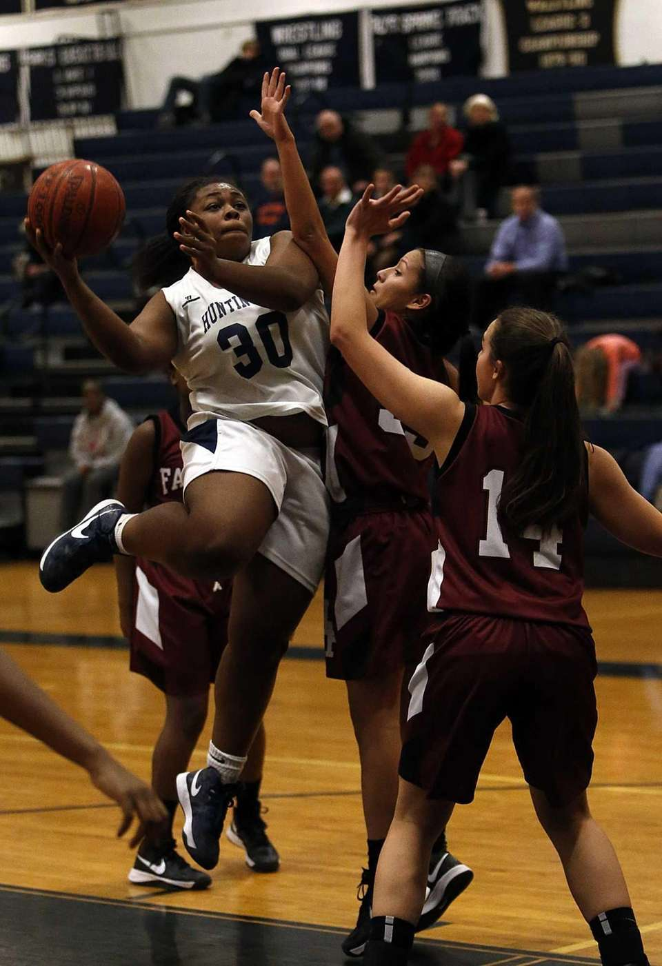 Huntington's Raynisha Witherspoon (30) drives to the hoop