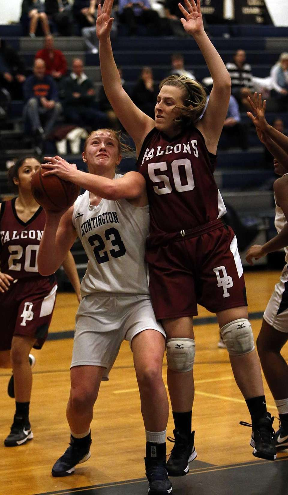 Huntington's Heather Forster (23) is fouled by Deer