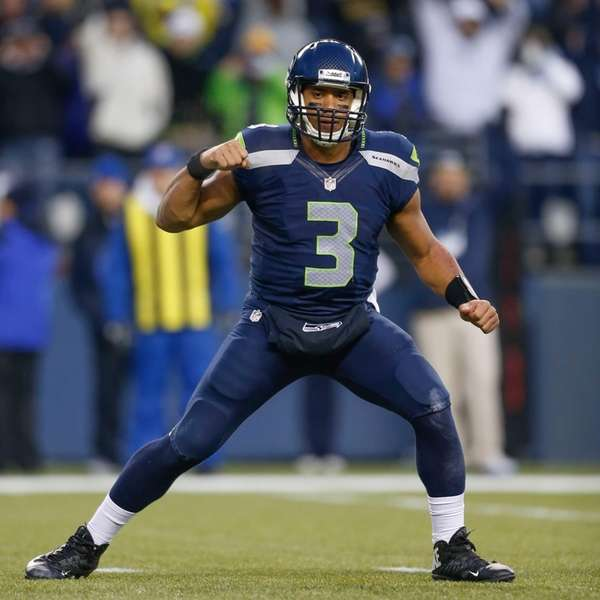 Seattle Seahawks quarterback Russell Wilson celebrates an apparent