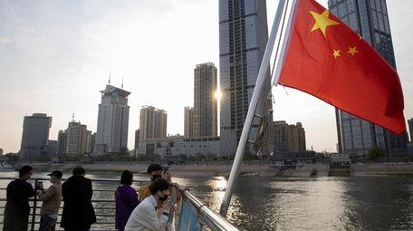 Passengers cross the Yangtze River on a ferry