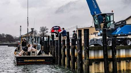 Buoys are loaded onto a boat in Freeport