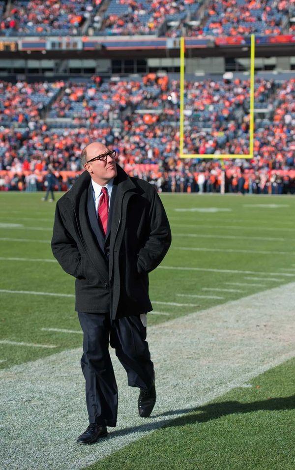 Kansas City Chiefs general manager Scott Pioli walks