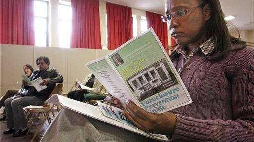 A workshop attendee looks over a guide on